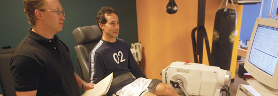 OrthoSport Physical Therapist Jeff Deets helps patient in Rehabilitation